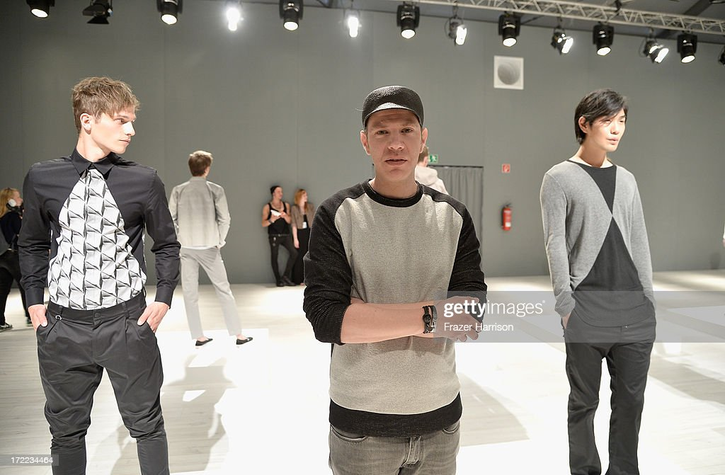 Designer Daniel Blechman (C) attends Sopopular show during Mercedes-Benz Fashion Week Spring/Summer 2014 at Brandenburg Gate on July 2, 2013 in Berlin, Germany.