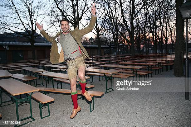 Designer Daniel Fendler jumps during the SIXT fashion dinner at Nockherberg on March 24 2015 in Munich Germany