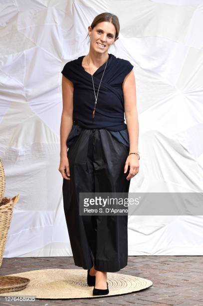 Designer Daniela Gregis acknowledges the applause of the audience at the Daniela Gregis fashion show during the Milan Women's Fashion Week on...