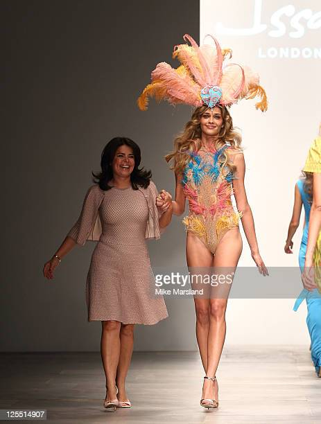 Designer Daniella Issa Helayel walks with model on the runway at the Issa London S/S 2012 show at London Fashion Week at Somerset House on September...