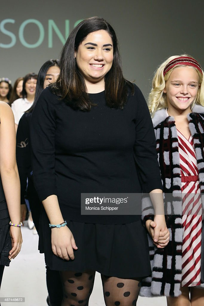 Designer Danielle Molina (L) walks the runway with a model during the Parsons preview at petitePARADE / Kids Fashion Week at Bathhouse Studios on October 18, 2014 in New York City.