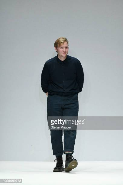 Designer Danny Reinke acknowledges the applause of the audience after his show during the Berlin Fashion Week Autumn/Winter 2019 at ewerk on January...