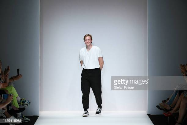 Designer Danny Reinke acknowledges the applause of the audience after his show during the Berlin Fashion Week Spring/Summer 2020 at ewerk on July 01,...