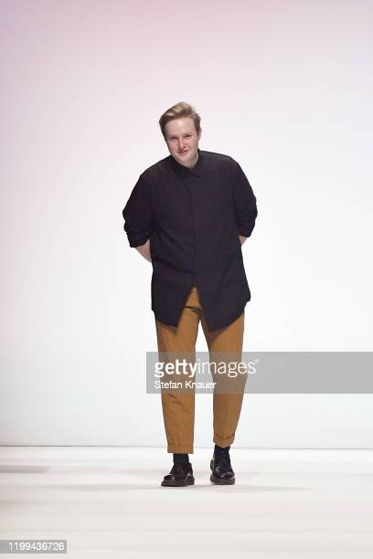 Designer Danny Reinke acknowledges the applause of the audience after his show during Berlin Fashion Week Autumn/Winter 2020 at Kraftwerk Mitte on...