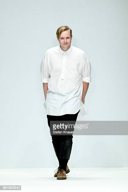 Designer Danny Reinke acknowledges the applause of the audience after his show during the Berlin Fashion Week Spring/Summer 2019 at ewerk on July 4,...