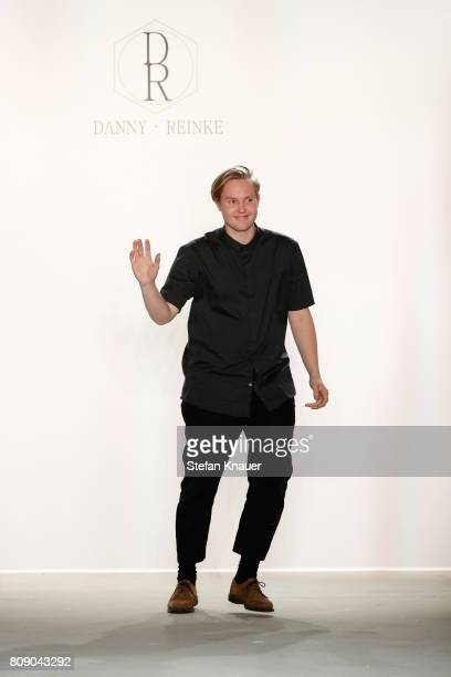 Designer Danny Reinke acknowledges the applause of the audience at the Danny Reinke show during the Mercedes-Benz Fashion Week Berlin Spring/Summer...