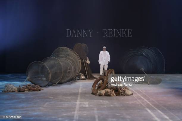 Designer Danny Reinke is seen on the runway after his show during the Mercedes-Benz Fashion Week Berlin January 2021 at Kraftwerk Mitte on January...