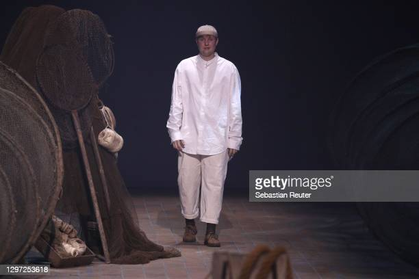 Designer Danny Reinke walks the runway after his show as part of the Mercedes-Benz Fashion Week Berlin January 2021 at Kraftwerk Mitte on January 19,...