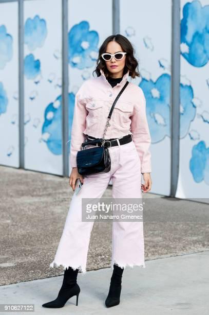 Designer Daria Vasilieva wears Mango shoes Zara trousers Daria Maria jacket and Gloria Ortiz handbag during Mercedes Benz Fashion Week Madrid Autumn...
