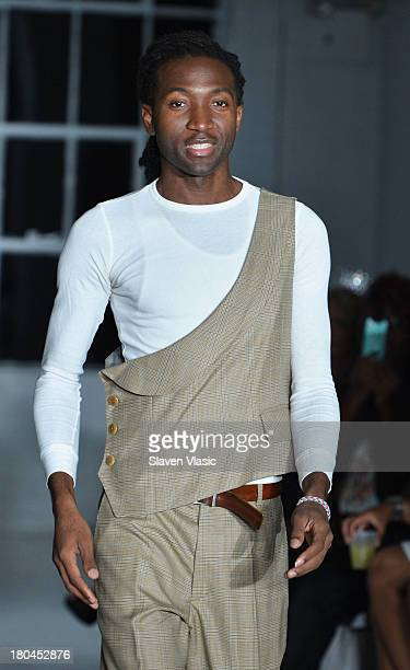 Designer Darius Wobil walks the runway at the St Wobil fashion show during MercedesBenz Fashion Week Spring 2014 at The Designer's Loft at Studio 450...