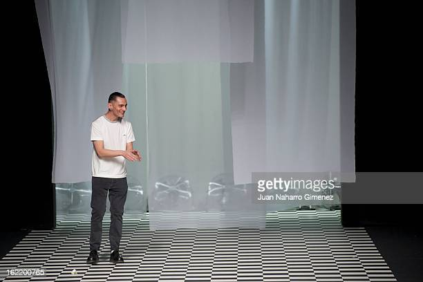 Designer David Delfin poses on the runway after his show at the Mercedes Benz Fashion Week Madrid Fall/Winter 2013/14 at Ifema on February 20 2013 in...