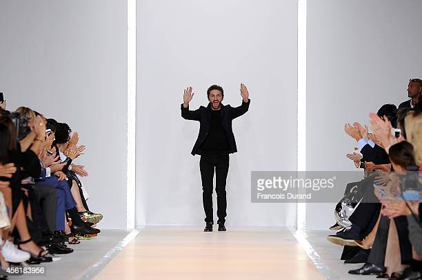 Designer David Koma appears at the end of the runway after the Mugler show as part of the Paris Fashion Week Womenswear Spring/Summer 2015 on...
