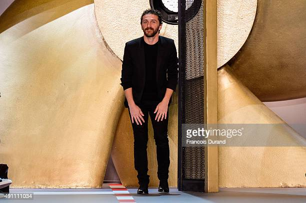 Designer David Koma walks the runway after the Mugler show as part of the Paris Fashion Week Womenswear Spring/Summer 2016 on October 3 2015 in Paris...