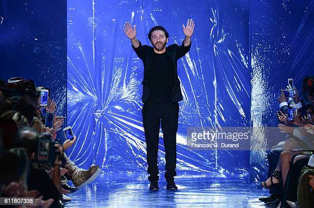 Designer David Koma walks the runway during the Mugler show as part of the Paris Fashion Week Womenswear Spring/Summer 2017 on October 1 2016 in...