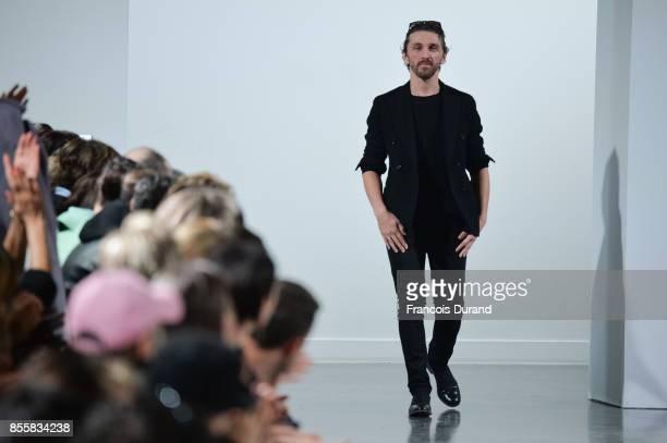 Designer David Koma walks the runway during the Mugler show as part of the Paris Fashion Week Womenswear Spring/Summer 2018 on September 30 2017 in...