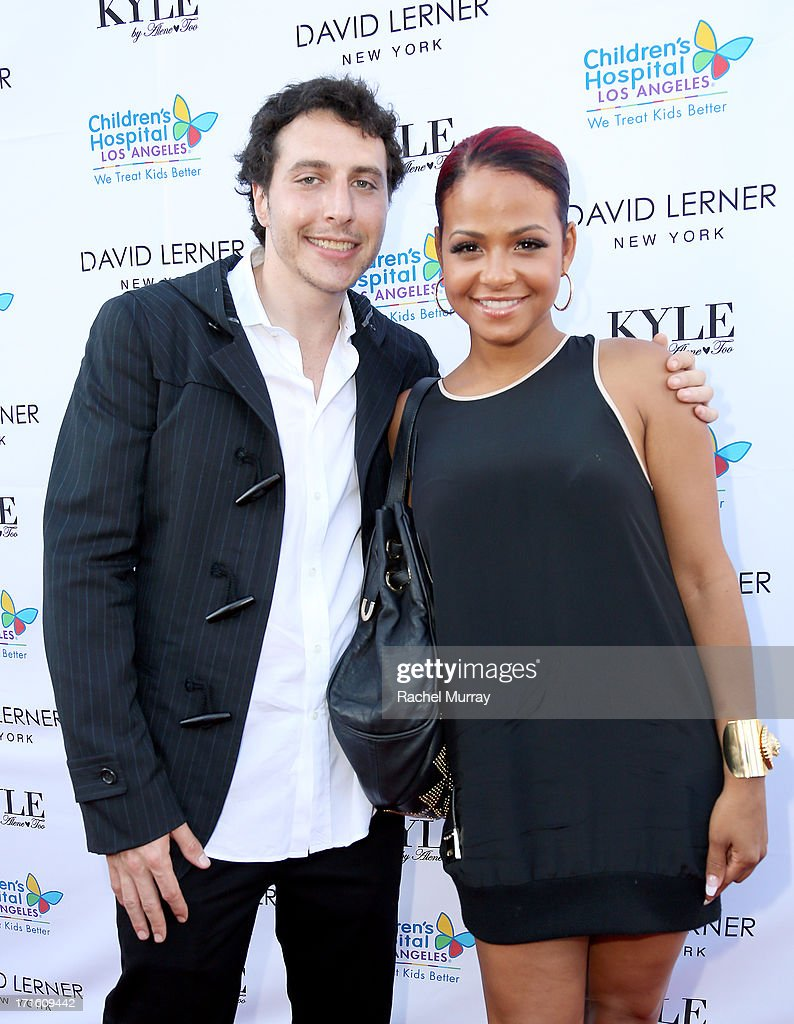 Designer David Lerner (L) and actress Christina Milian attend Kyle Richards hosts a Fashion Fundraiser for Children's Hospital Los Angeles at Kyle By Alene Too on June 26, 2013 in Beverly Hills, California.