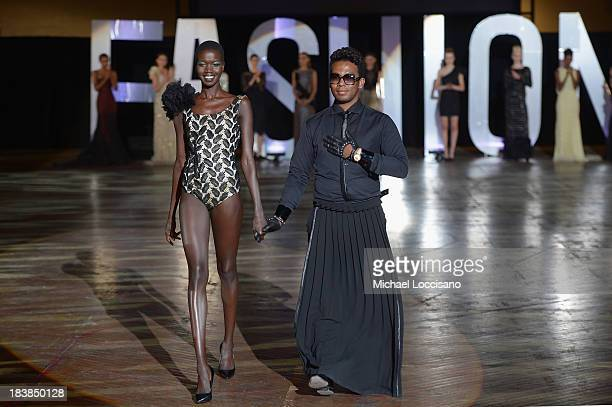 Designer David Tlale and a model wearing his design walk the runway during the 3rd Annual United Colors Of Fashion Gala at Lexington Avenue Armory on...