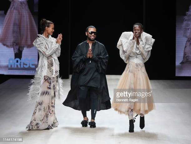 Designer David Tlale greets the audience during Arise Fashion Week on April 20 2019 in Lagos Nigeria