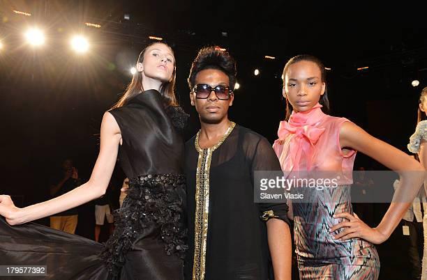 Designer David Tlale poses with models at the David Tlale Spring 2014 fashion presentation during MercedesBenz Fashion Week at The Box at Lincoln...