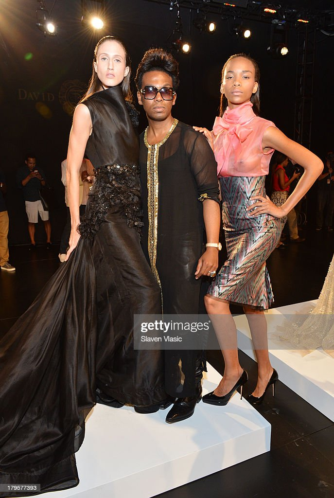Designer David Tlale (C) poses with models at the David Tlale Spring 2014 fashion presentation during Mercedes-Benz Fashion Week at The Box at Lincoln Center on September 5, 2013 in New York City.