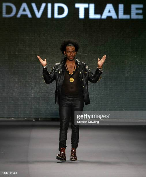 Designer David Tlale walks the runway wearing David Tlale at This Day/Arise African Fashion Collective 2010 Fashion Show at the Promenade at Bryant...
