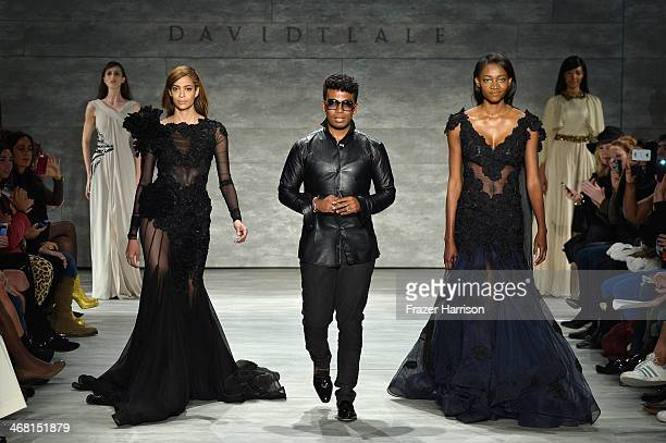 Designer David Tlale walks the runway with models at the David Tlale fashion show during MercedesBenz Fashion Week Fall 2014 at Lincoln Center on...