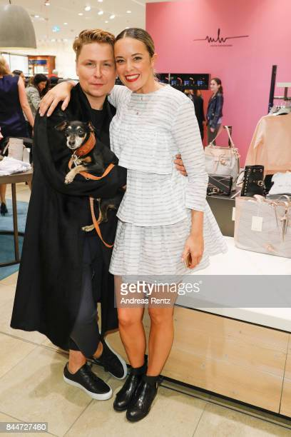 Designer Dawid Tomaszewski and Marina Hoermanseder attend the VOGUE Fashion's Night Out Duesseldorf on September 8 2017 in Duesseldorf Germany