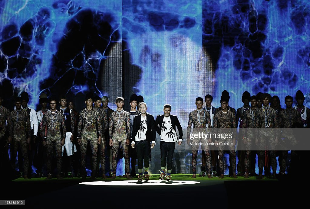 Designer Dean and Dan Caten acknowledge the applause of the public after the DSquared2 show as part of Milan Men's Fashion Week Spring/Summer 2016 on June 23, 2015 in Milan, Italy.