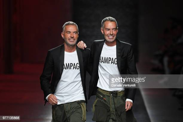 Designer Dean and Dan Caten acknowledge the audience at the end of the Dsquared2 show during Milan Men's Fashion Week Spring/Summer 2019 on June 17...