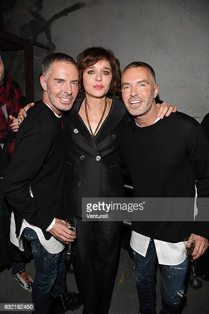 Designer Dean and Dan with Valeria Golino arrive at the Dsquared2 show during Milan Men's Fashion Week Fall/Winter 2017/18 on January 15 2017 in...
