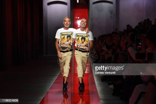 Designer Dean Caten and Dan Caten walk the runway at the DSquared2 Ford fashion show during the Milan Men's Fashion Week Spring/Summer 2020 on June...
