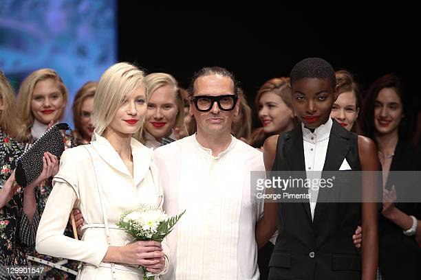 Designer Denis Gagnon with models presents his spring 2012 collection at David Pecaut Square on October 21 2011 in Toronto Canada