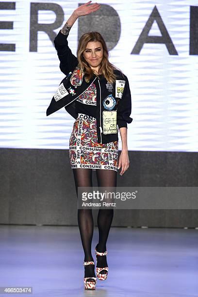 Designer Deniz Berdan walks the runway at the Deniz Berdan show during Mercedes Benz Fashion Week Istanbul FW15 on March 16 2015 in Istanbul Turkey