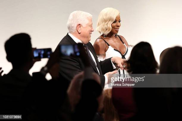 Designer Dennis Basso and Mary J Blige walk the runway at the Dennis Basso fashion show during New York Fashion Week at Cipriani 42nd Street on...