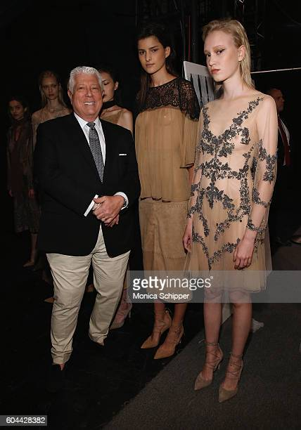 Designer Dennis Basso poses backstage with models at the Dennis Basso fashion show during New York Fashion Week The Shows at The Arc Skylight at...