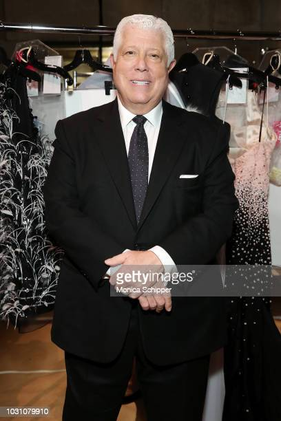 Designer Dennis Basso poses for a photo backstage before the Dennis Basso fashion show during New York Fashion Week at Cipriani 42nd Street on...