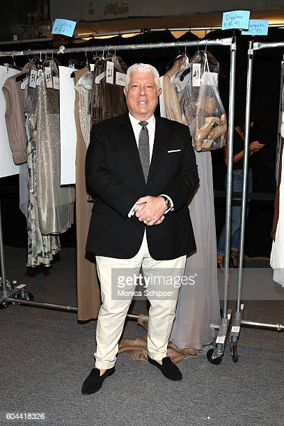 Designer Dennis Basso poses with his creations backstage at the Dennis Basso fashion show during New York Fashion Week The Shows at The Arc Skylight...