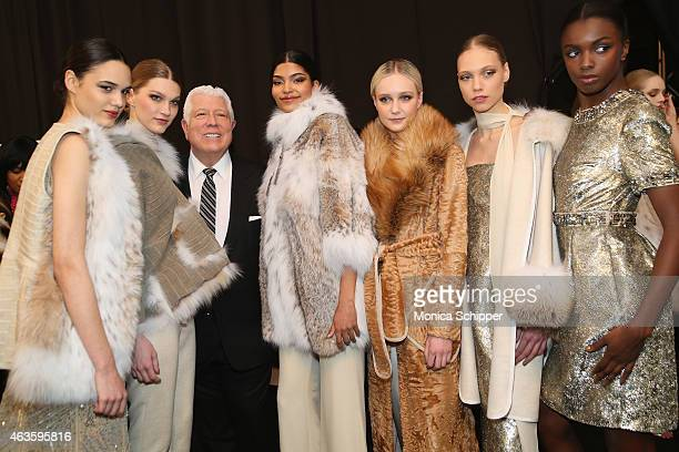Designer Dennis Basso poses with models backstage at the Dennis Basso fashion show during MercedesBenz Fashion Week Fall 2015 at The Theatre at...