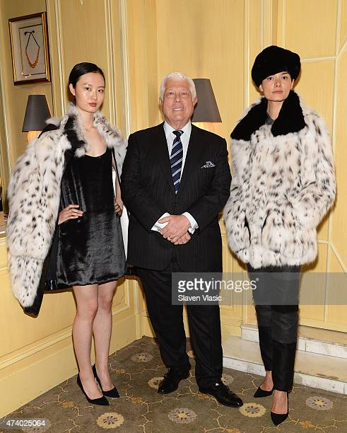 Designer Dennis Basso poses with models wearing his lattest collection at High Tea High Fashion with Dennis Basso benefiting New York Botanical...