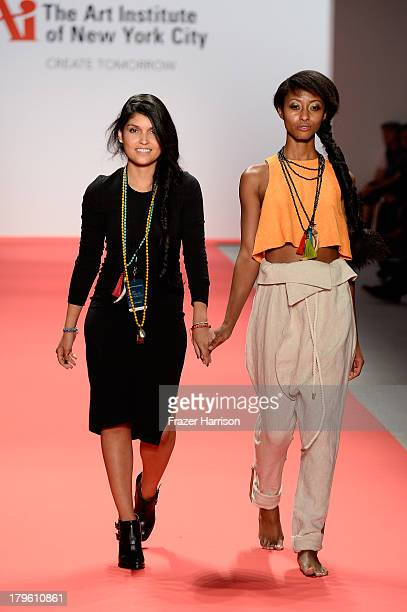 Designer Diana Isabel Sanchez Sacotto walks with a model on the runway at the The Art Institute Of New York City Spring 2014 fashion show during...