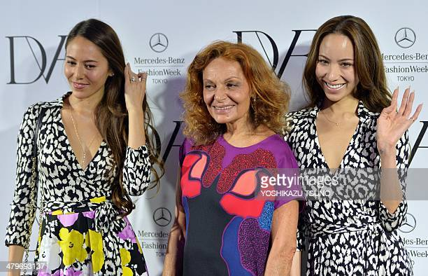 Designer Diane von Furstenberg smiles with Japanese models Jessica Michibata and Angelica Michibata after the presentation of her 20142015...