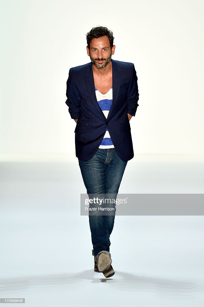 Designer Dimitri Panagiotopoulos walks the runway at the end of the Dimitri show during Mercedes-Benz Fashion Week Spring/Summer 2014 at Brandenburg Gate on July 3, 2013 in Berlin, Germany.