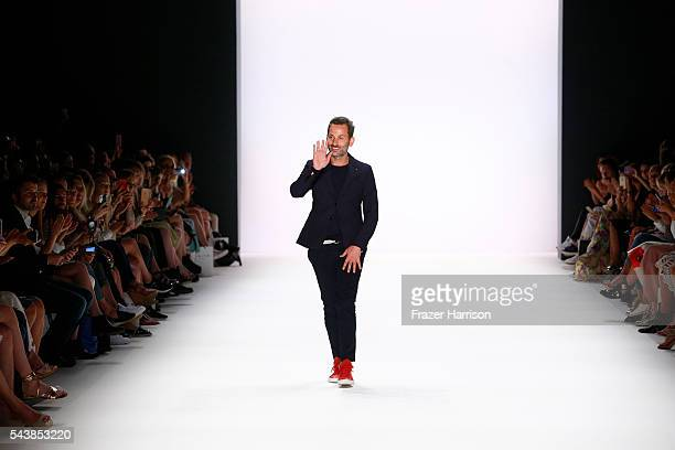 Designer Dimitrios Panagiotopoulos acknowledges the applause of the audience after the Dimitri show during the MercedesBenz Fashion Week Berlin...