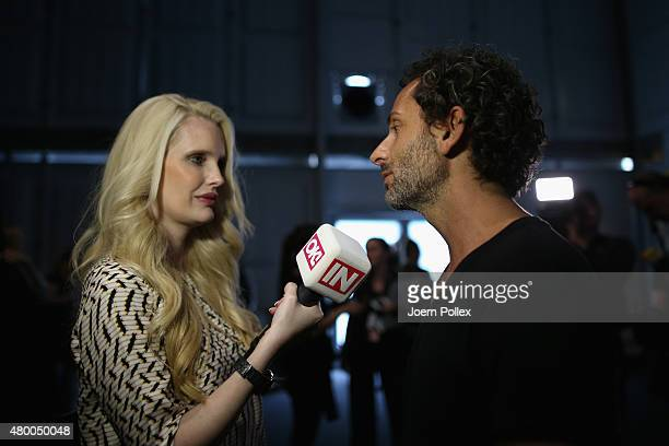 Designer Dimitrios Panagiotopoulos is being interviewed by Mirja du Mont backtstage ahead of the Dimitri show during the Mercedes-Benz Fashion Week...