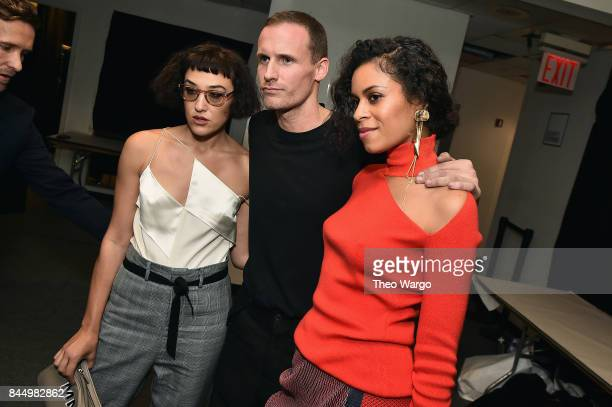 Designer Dion Lee poses with actress Mia Moretti and musician Aluna Francis backstage for the Dion Lee fashion show during New York Fashion Week The...