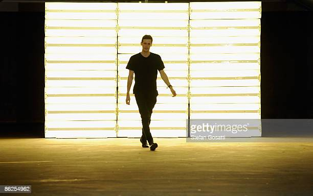 Designer Dion Lee walks on the catwalk after his show at the Kings Cross Car Park on day two of Rosemount Australian Fashion Week Spring/Summer...