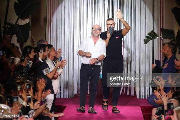 Designer Domenico Dolce and Stefano Gabbana acknowledge the applause of the audience at the Dolce Gabbana Naked King Secret Show show during Milan...