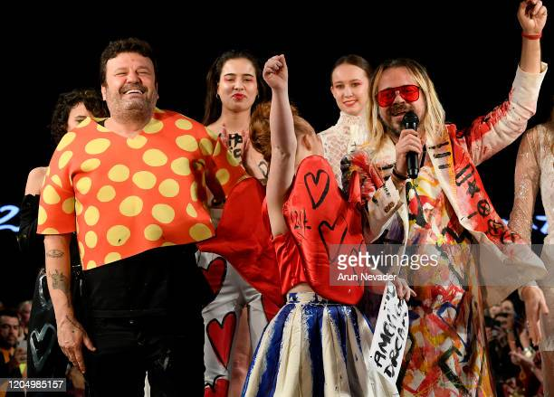 Designer Domingo Zapata and Madeline Stuart walk the runway during Domingo Zapata At New York Fashion Week Powered By Art Hearts Fashion NYFW 2020 at...