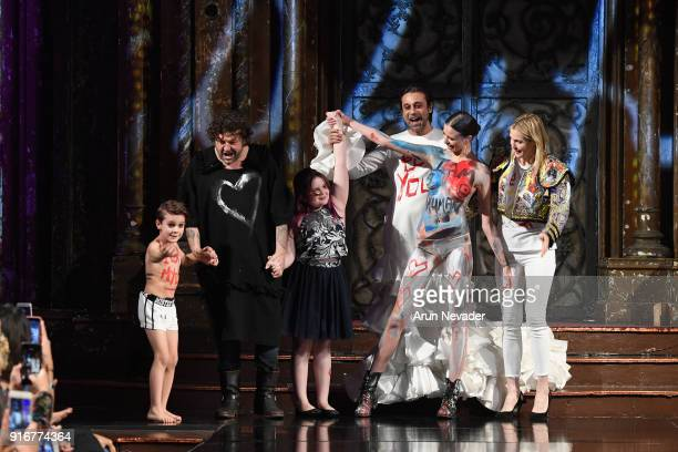 Designer Domingo Zapata and models take a final bow on the runway during the Domingo Zapata presentation at New York Fashion Week Powered by Art...