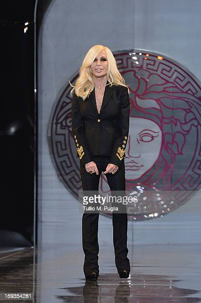Designer Donatella Versace acknowledges the applause of the audience after the Versace show as part of Milan Fashion Week Menswear Autumn/Winter 2013...